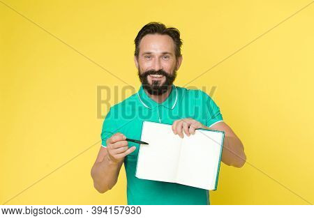 Can You Sign Here, Please. Time Management Skills. Man Planning Schedule Hold Notepad. Man Bearded M