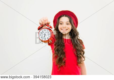 Parisian Child On Yellow. Beauty Hairdresser. Child With Alarm Clock. Timeless Fashion. Happy Girl W