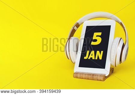 January 5th. Day 5 Of Month, Calendar Date. Stylish Headphones And Modern Tablet On Yellow Backgroun