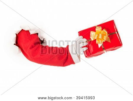 Santa Claus hand holding a gift