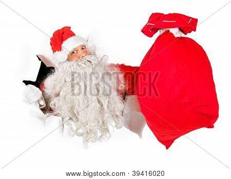 Santa Claus holding a bag