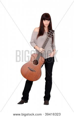 Woman posing with her guitar