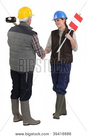 Tradespeople shaking hands