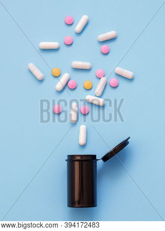 Opioid Epidemic, Painkillers And Drug Abuse Concept With Close Up On A Bottle Of Prescription Drugs