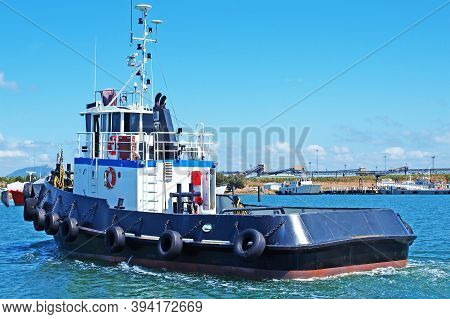 An 18 Meter Twin Screw Commercial Tug Boat Under Way In Gladstone Marina Harbour. Gladstone, Queensl