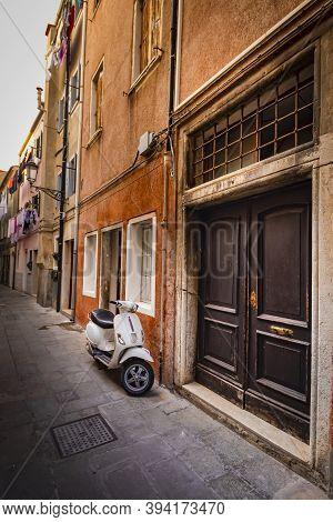 8 November 2020 Venice Italy - Classic Scooter Vespa In Typical Narrow Italian Street