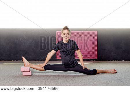 A Young Man Performs Flexibility And Endurance Exercises. Boy Blogger.