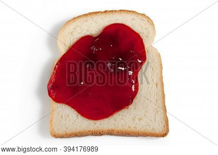Slice Of Bread With Strawberry Jam On A White Background