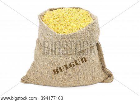 Bulgur Couscous In A Sack Isolated On A White Background. Bulgur In Burlap Sack. Bulgur In Jute Bag.