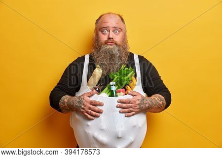 Bothered Surprised Bearded Man Stocks Up On Products, Eats Too Much Junk Food, Has Good Appetite, Su