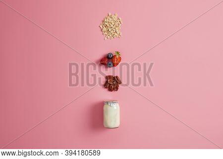 Preparing Healthy Oatmeal Porridge For Eating. Jar Of Natural Yoghurt, Wholenut, Ripe Blueberry, Str