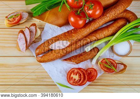 Tomatoes, Bread And Kielbasa With Chives On Wooden Background. Close Up.