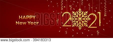 Happy New 2021 Year. Hanging Golden Metallic Numbers 2021 With Shining Snowflake And Confetti On Red
