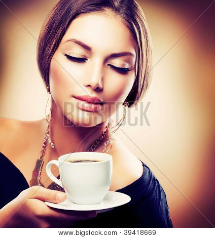 Coffee. Beautiful Girl Drinking Tea or Coffee. Cup of Hot Beverage.Sepia Toned