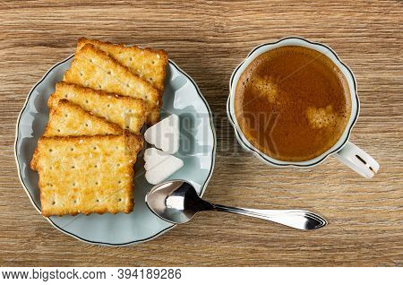 Crunchy Cookies With Sesame, Pieces Of Sugar In Saucer, Coffee Espresso In Light-blue Cup, Spoon On