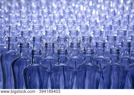 Selective Focus And Close Up Of An Arrangement Of Empty Glass Bottles. Glass And Abstract Concept.