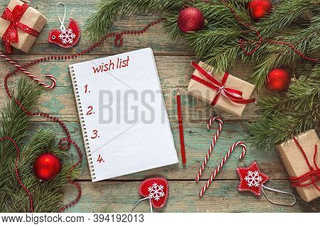 Christmas Notebook With Wish List, Fir Branches And Decorations On Wooden  Background. Space For Tex