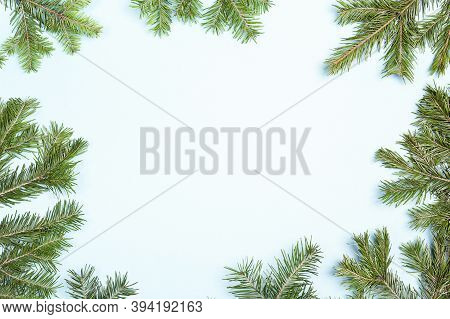 Christmas Green Framework Isolated On Blue Background. Green Christmas Fir Tree Branches With Copy S