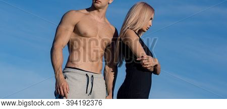 Sporty Couple. Sexy Slim Active Couple Straight Body Sportswear Outdoor Blue Sky Background. Regular