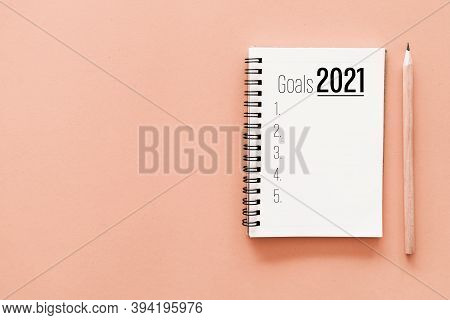 2021 New Year Goals On Notebook With Pencil.