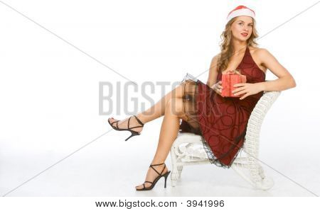 Sexy Blonde Woman Mrs. Claus With Christmas Gift