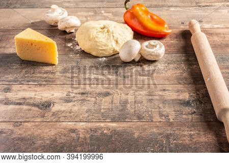 Pizza Cooking Ingredients On Wooden Rustic Table. Copyspace. Raw Dough For Pizza Preparation With In