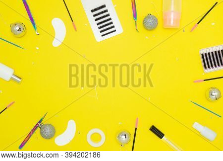 Tools For Eyelash Extension On A Yellow Background. Tweezers, Artificial Eyelashes, Patches, Microbr