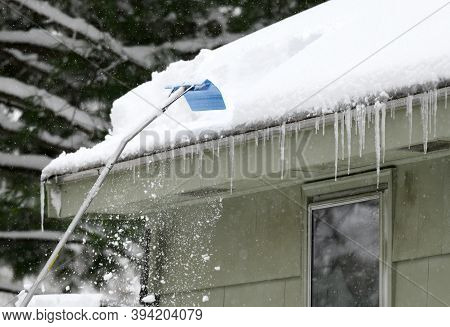 Removing Snow On The Roof After Snow Storm