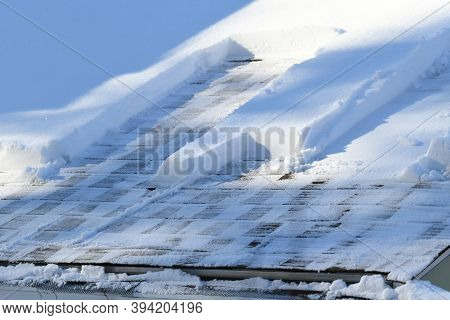Snow Removal On The Roof After Snow Storm