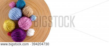 Funny Multicolored Woolen Balls In Wooden Bowl Isolated On White Background. Top View. Close Up. Kni