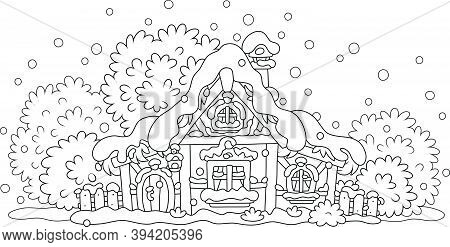 Snow-covered Small Wooden House In A Village From A Fairytale On A Snowy And Frosty Winter Night On