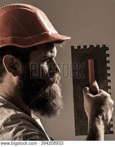 Mason Plastering Concrete To Build. Plastering Tools. Tool, Trowel, Handyman, Man Builder. Mason Too