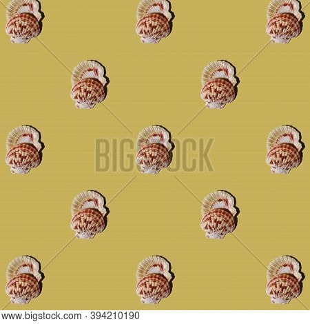 Seamless Pattern. Repeating Seashells On A Yellow Background. Abstract Yellow Background.