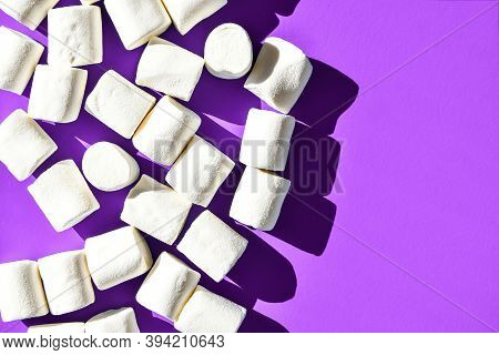 Marshmallows On Purple Background With Copy Space. Flat Lay. Top View. Background Or Texture Of Colo