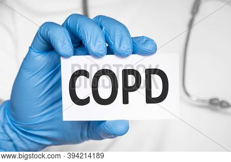 Doctor Holding A Card With Text Copd Chronic Obstructive Pulmonary Disease., Medical Concept
