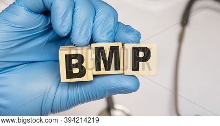 Bmp Basic Metabolic Panel - Word From Wooden Blocks With Letters Holding By A Doctors Hands In Medic