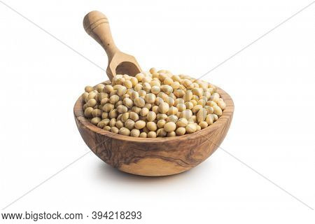 Dried soy beans in wooden bowl isolated on a white background.