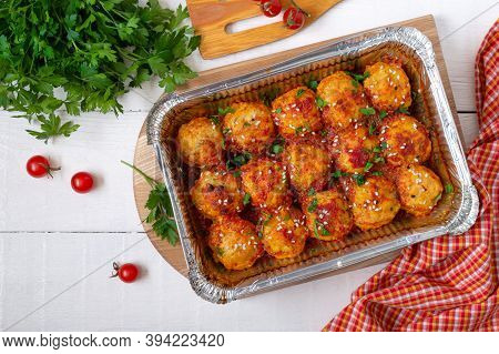 Meatballs In Tomato Sauce Baked In An Aluminum Foil Container. Diet Meat Dish. The Top View