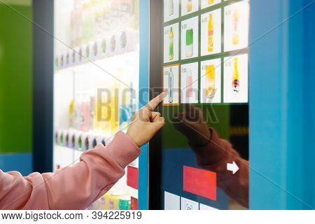 Sell, Technology And Consumption Concept, Woman Buying With A Vending Machine