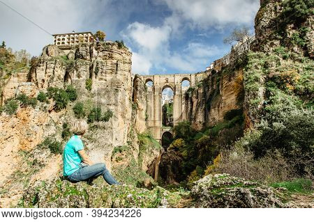 Woman Traveler Enjoying A Gorgeous View Of Ronda,spain.the Puente Nuevo New Bridge Over Guadalevin R
