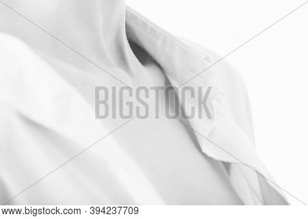 Beautiful Female Body With Clavicles In Shirt On White Background, Monochrome