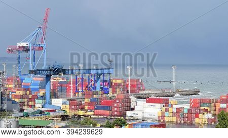 Cargo Container Terminal At Maritime Port. Logistic Import Export Background. Sunny Weather After St