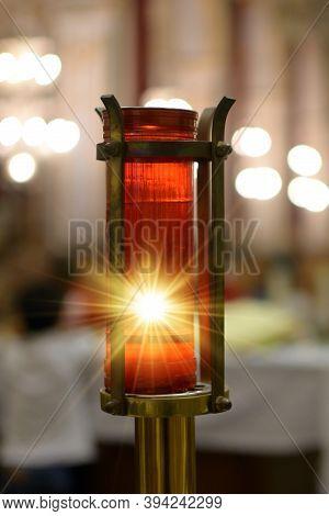 Votive Candle Lit Inside A Church Representing Divine Light.divine Light.