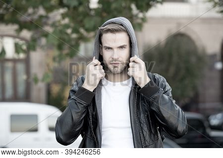 Hooded And Protected. Handsome Man Unshaven Face And Stylish Hair. Caucasian Man Urban Background. B