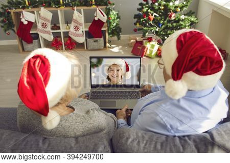 Grandparents In Santa Caps Video Calling Their Little Granddaughter On Christmas Day