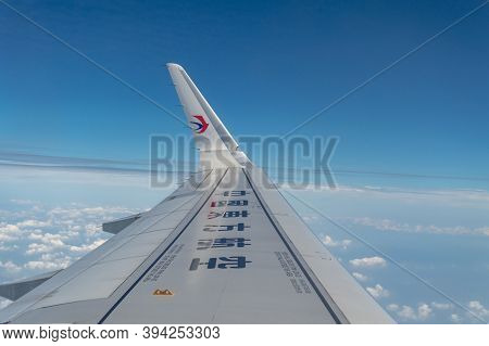 Wing Of An Airbus A321 Airplane Of China Eastern Airlines With Sky Background