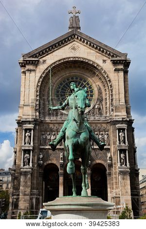 Jeanne d'Arc statue, Paris France. Saint Augustin church in the background poster