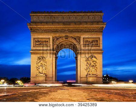 Arc de Triomphe, Paris, France at night. View from Avenue des Champs-Elysees