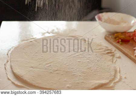 Preparation Of The Dough For Pizza. Hands Prepare The Dough