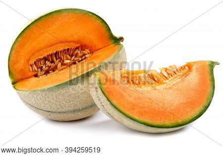 Ripe Delicious Melon And A Piece Of Melon Are Isolated On A White Background.
